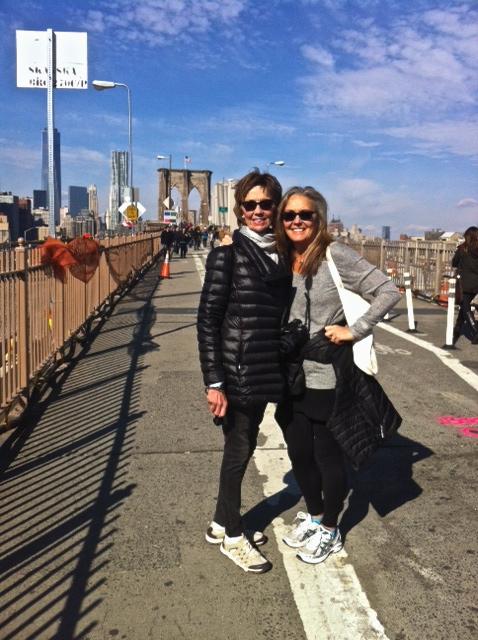Old friends walking across the Brooklyn Bridge